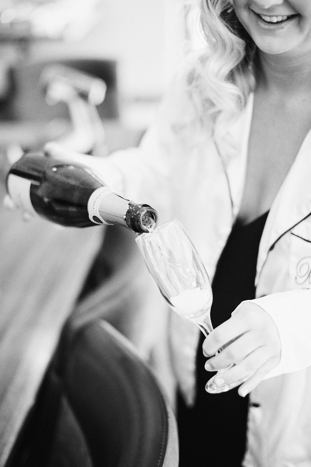 Black and white images of bridesmaid pouring champagne at Estate Tuscany Pokolbin in the Hunter Valley by wedding photographer Joshua Witheford