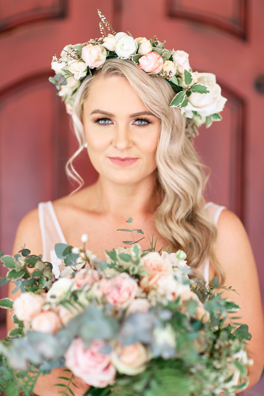 Close up of bride wearing flower crown at Estate Tuscany Pokolbin in the Hunter Valley by wedding photographer Joshua Witheford