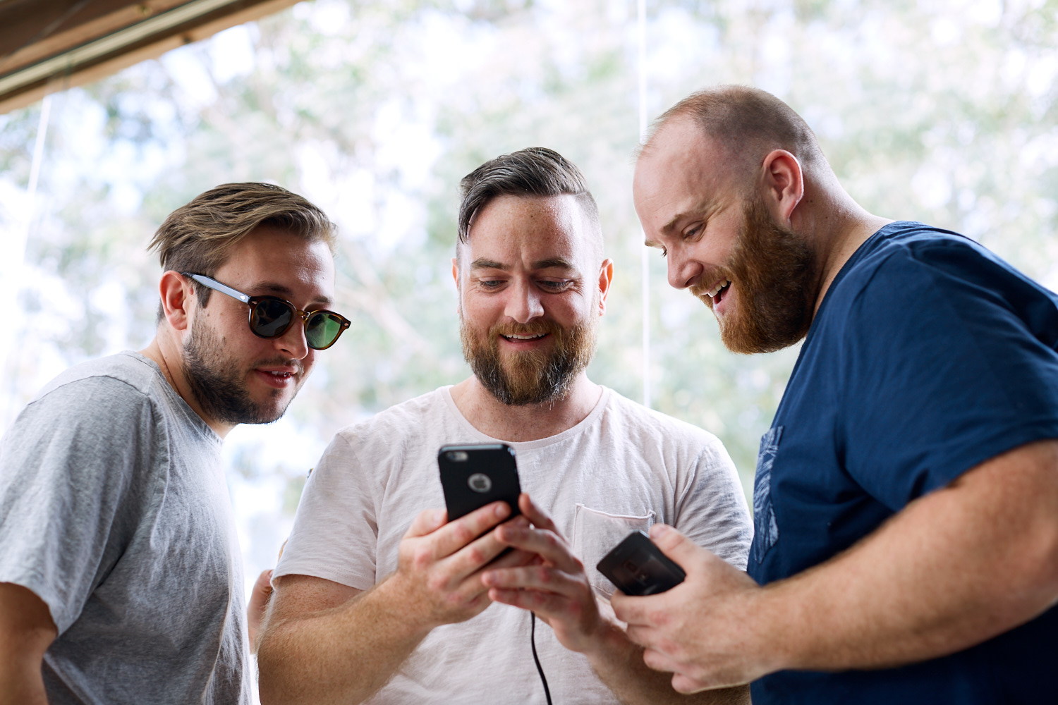 Groomsmen on phone. at Estate Tuscany Pokolbin in the Hunter Valley by wedding photographer Joshua Witheford