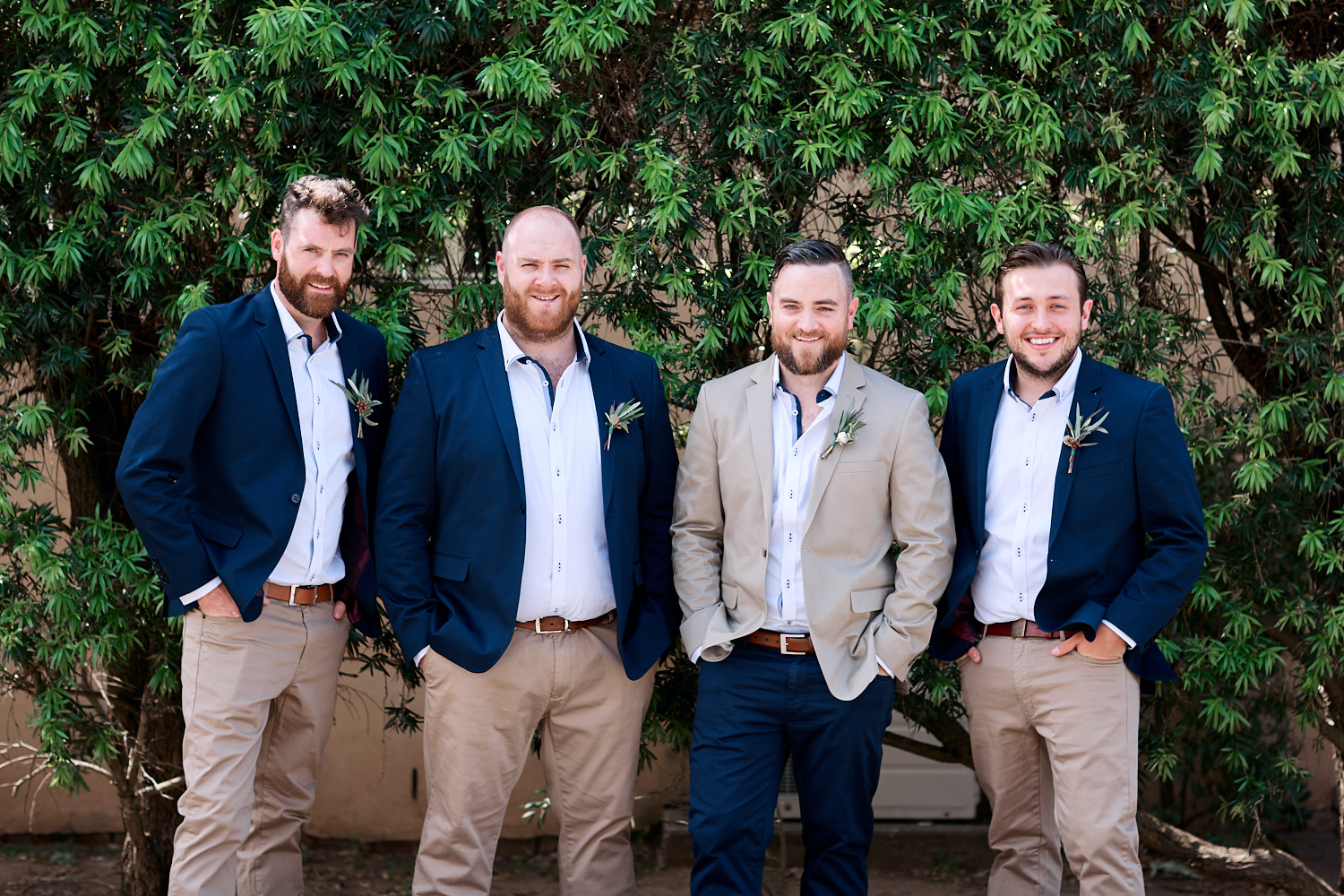 Groomsmen in front of hedge at Estate Tuscany Pokolbin in the Hunter Valley by wedding photographer Joshua Witheford