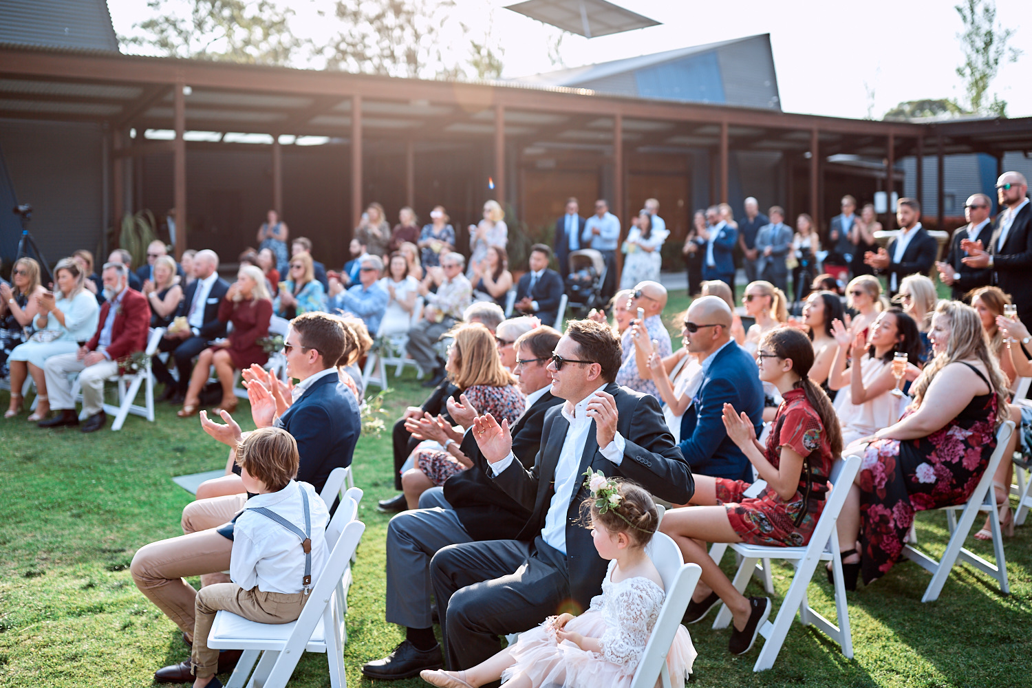 Wedding guests clapping during ceremony at at Estate Tuscany Pokolbin in the Hunter Valley by wedding photographer Joshua Witheford