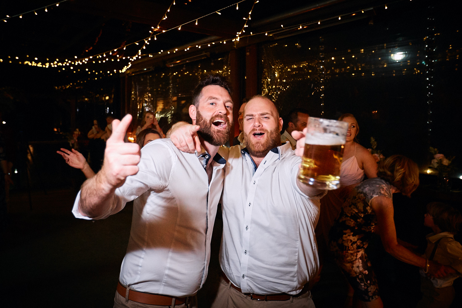 Guests celebrate during reception at Estate Tuscany Pokolbin in the Hunter Valley by wedding photographer Joshua Witheford