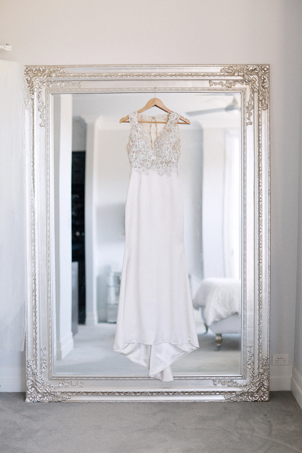 Wedding dress hung on mirror by Blue Mountains wedding photographer Joshua Witheford