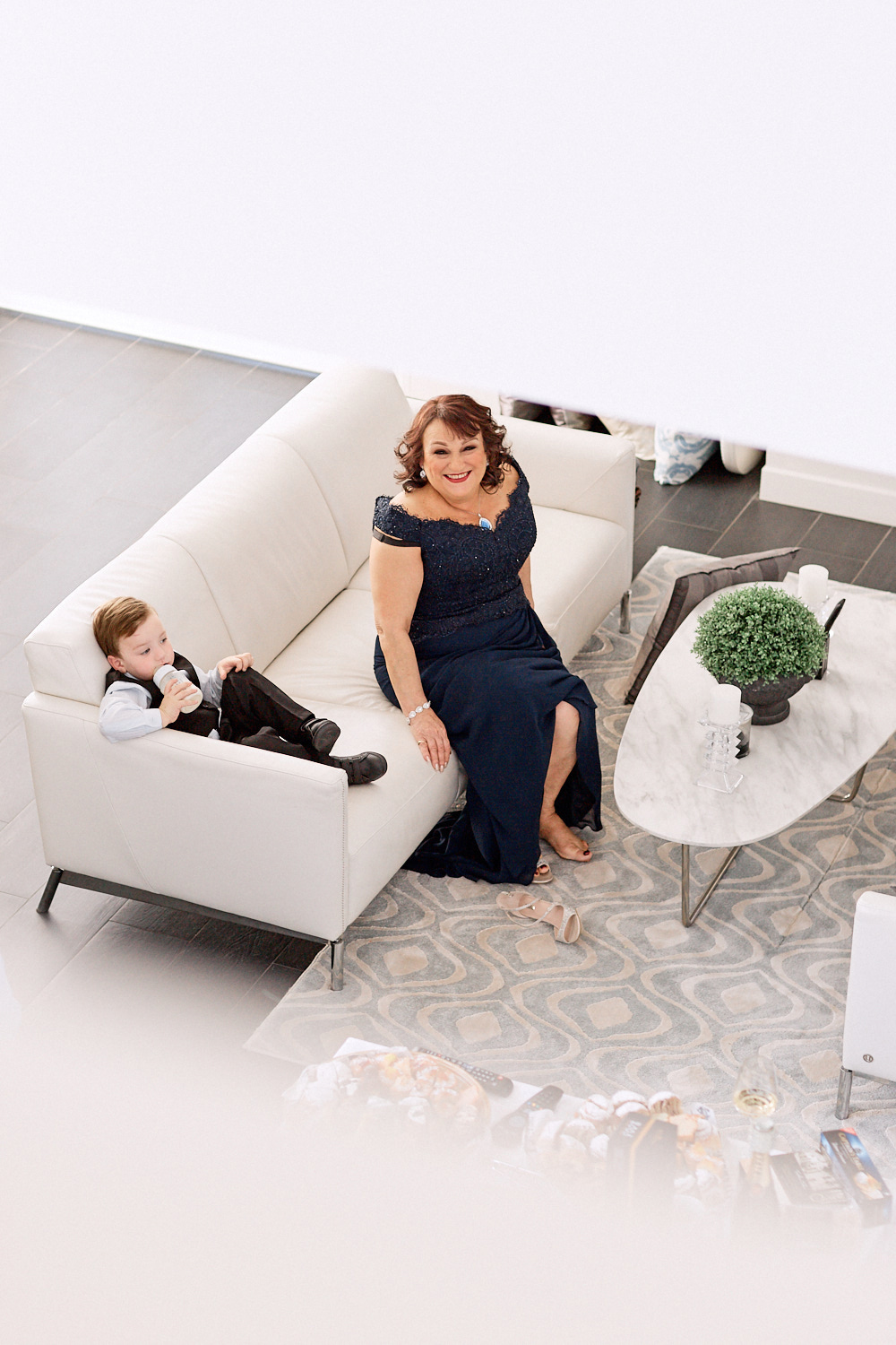 Mother of the bride waiting on couch by Blue Mountains wedding photographer Joshua Witheford
