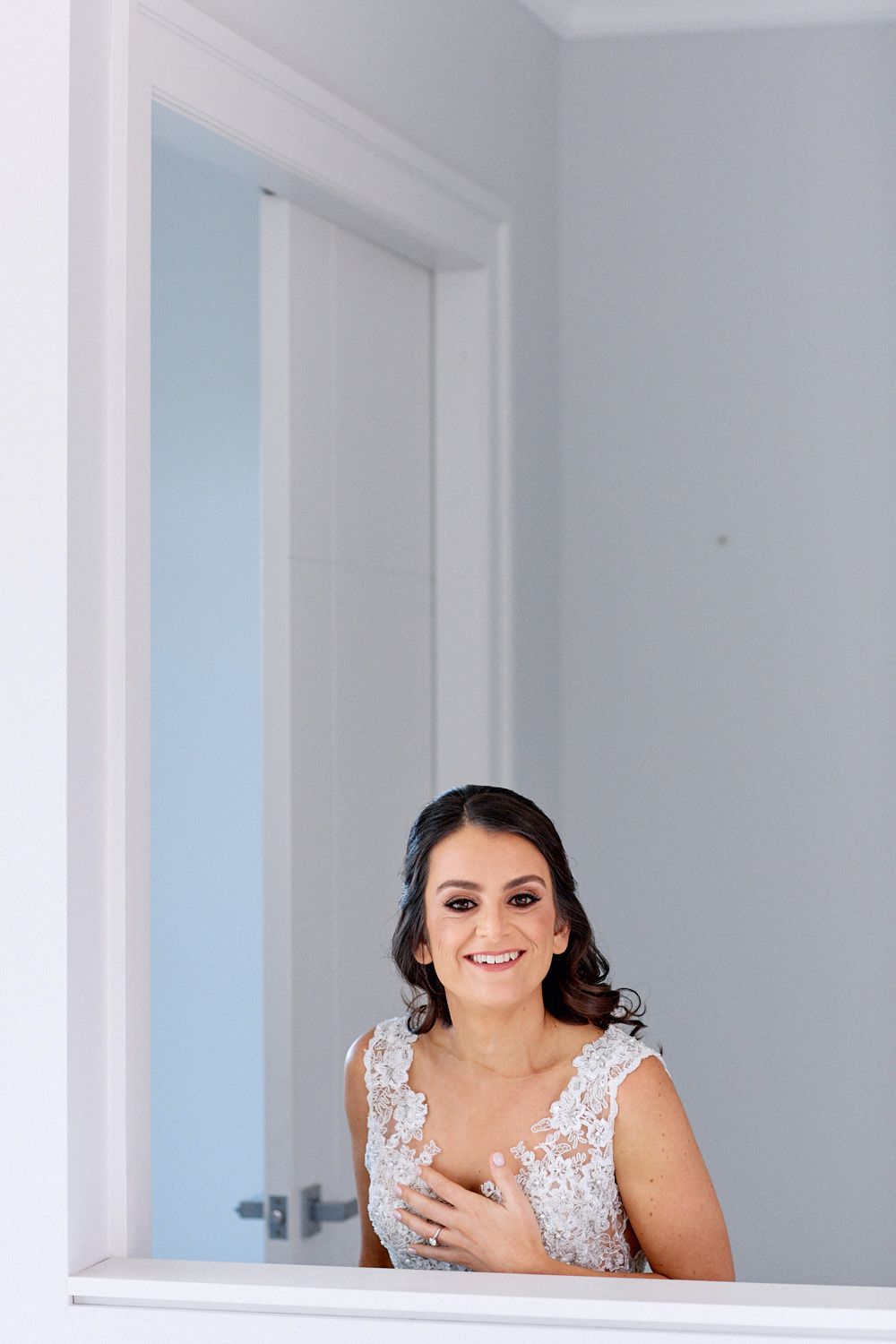 Bride smiling over balustrade by Blue Mountains wedding photographer Joshua Witheford