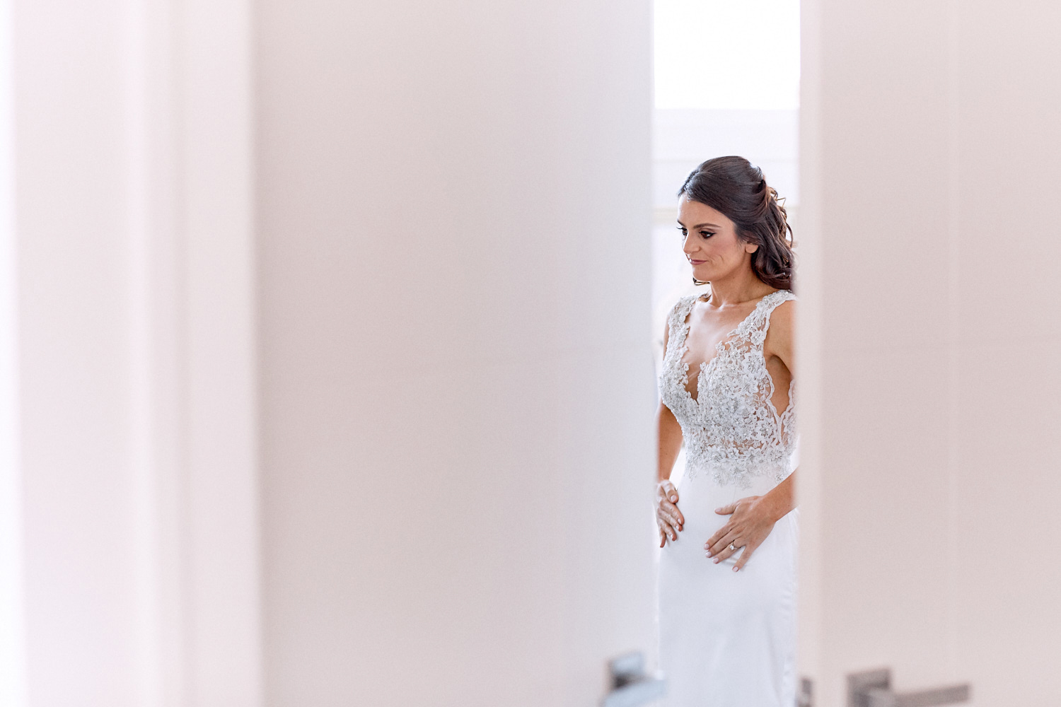 View of bride dressing through door by Blue Mountains wedding photographer Joshua Witheford