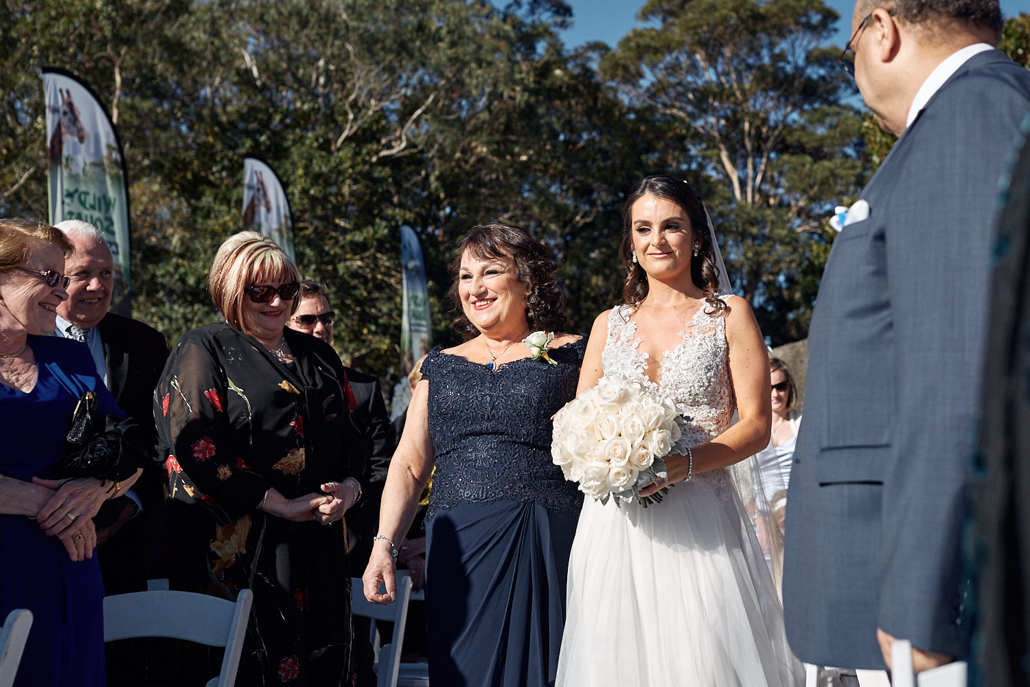 Mother walking bride down the aisle on the Centenary Theatre terrace at Taronga Zoo by Blue Mountains wedding photographer Joshua Witheford