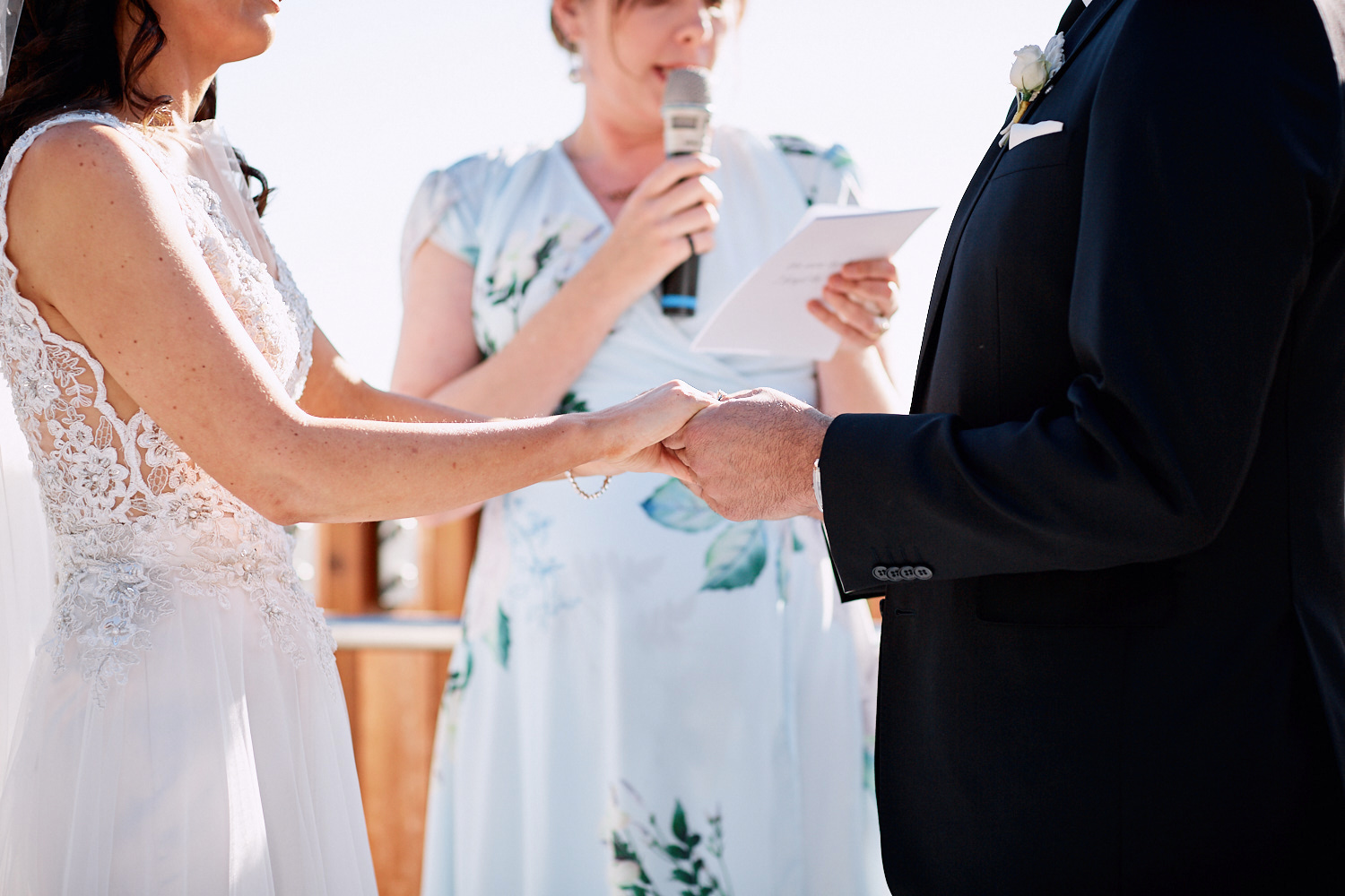 Close up holding hands by Blue Mountains wedding photographer Joshua Witheford