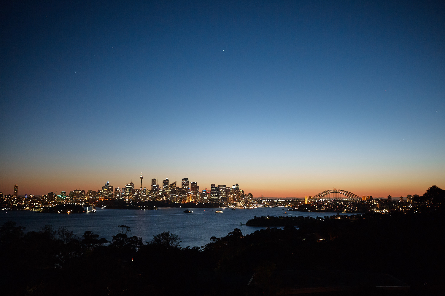 View of Sydney Skyline lights from the Taronga Centre by Blue Mountains wedding photographer Joshua Witheford