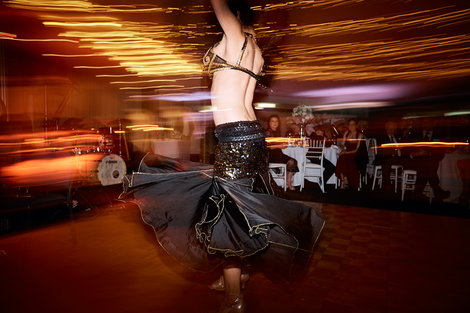 Belly dancer in black skirt at reception in the Taronga Centre by Blue Mountains wedding photographer Joshua Witheford