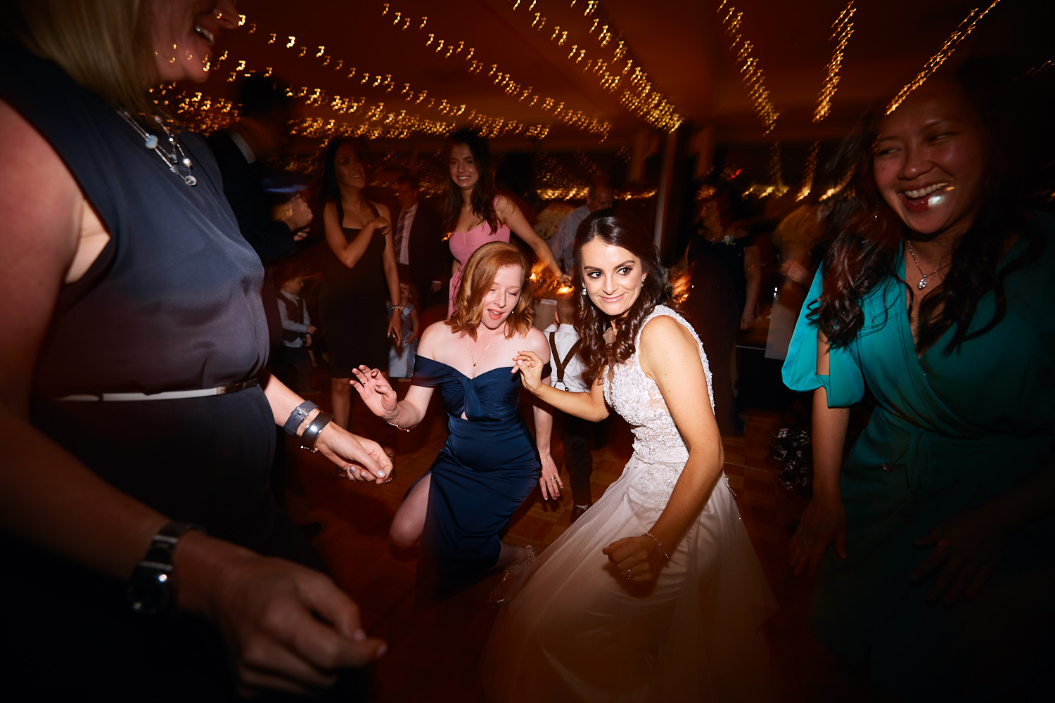 Bride dancing with guests on dance floor at Taronga Centre by Blue Mountains wedding photographer Joshua Witheford