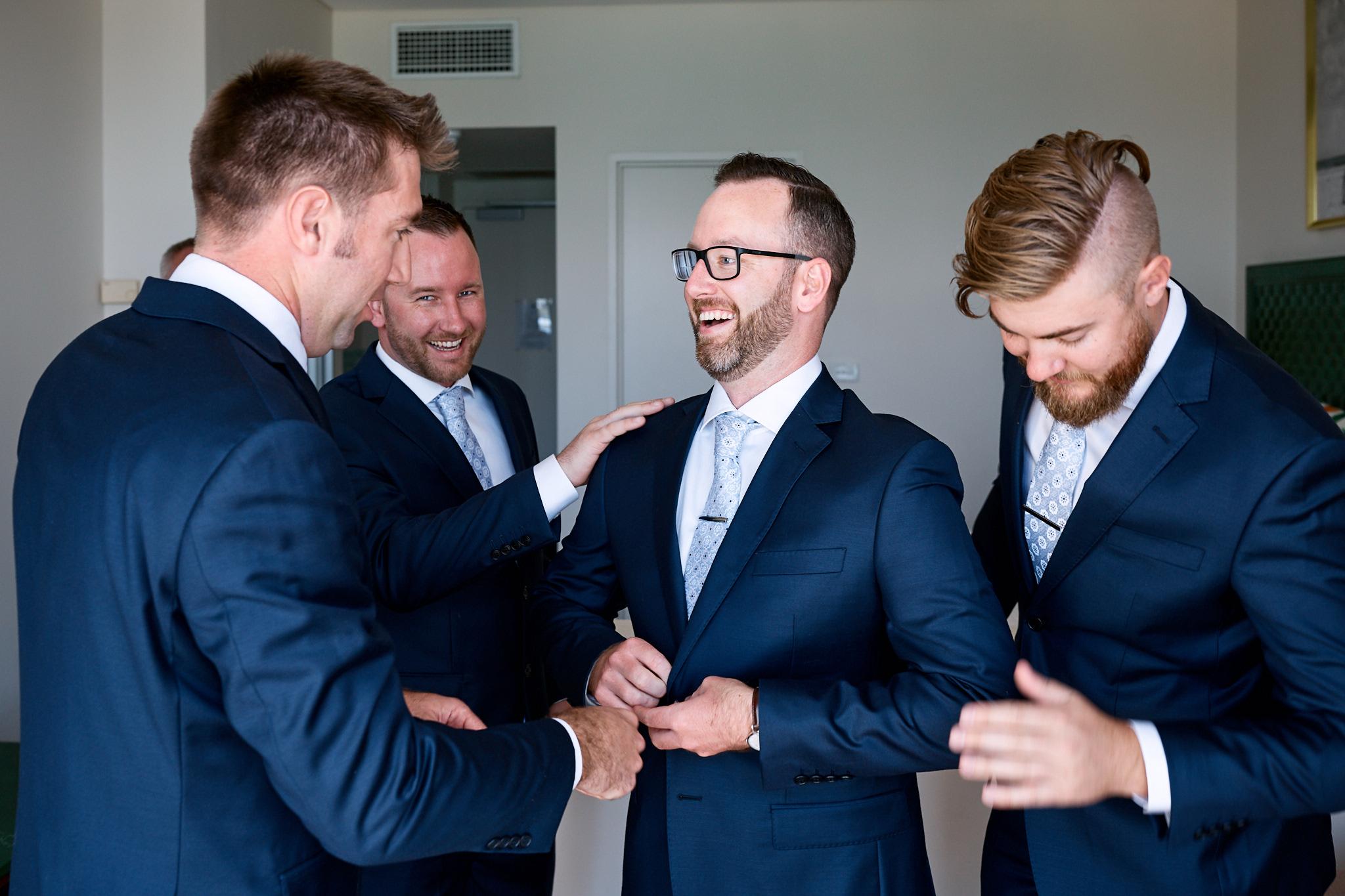 groomsmen getting dressed.jpg