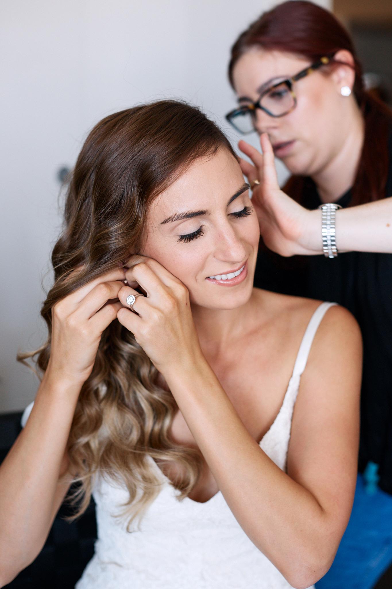 bride putting on earings.jpg