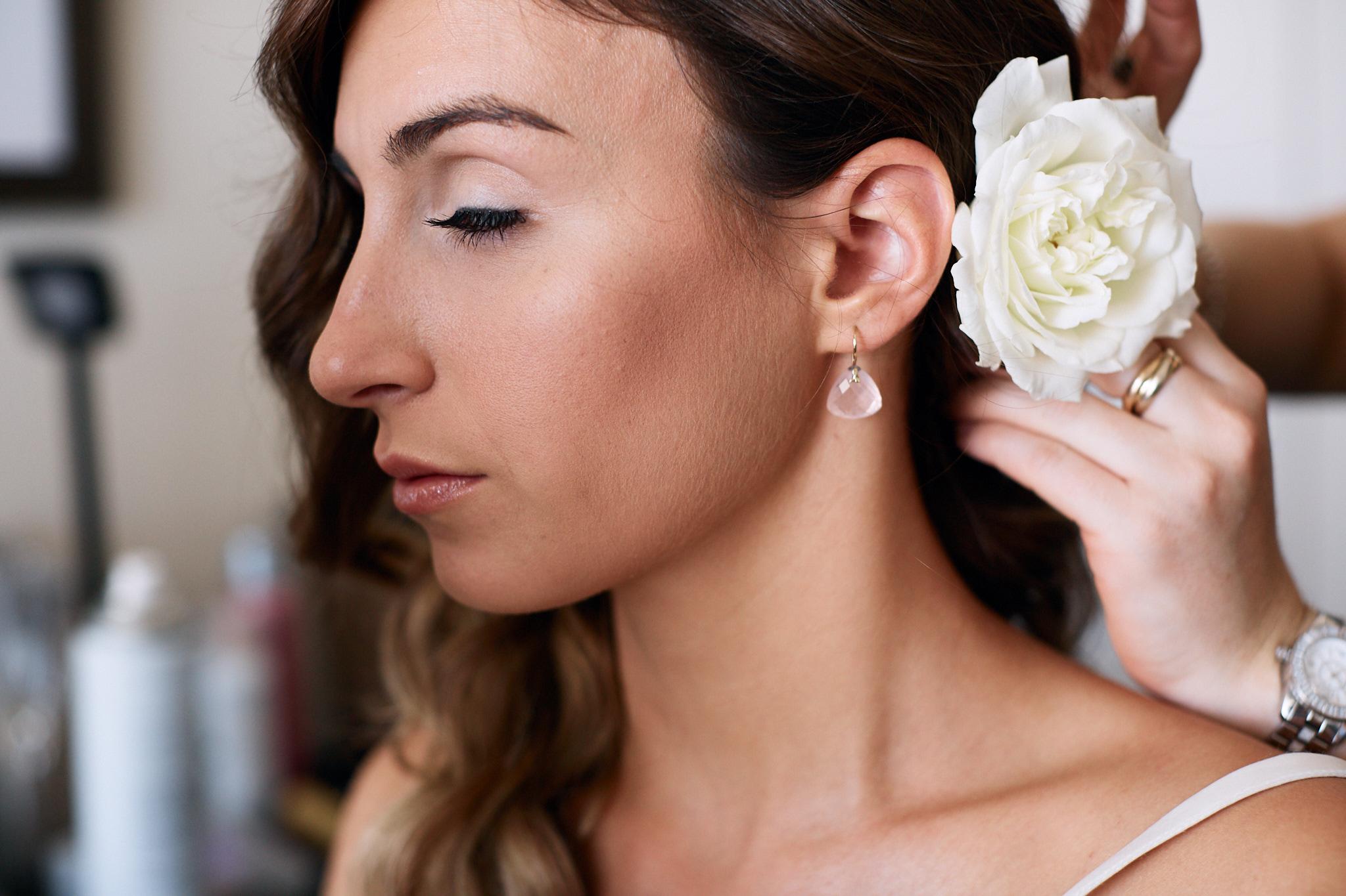bride earing and flower in hair.jpg