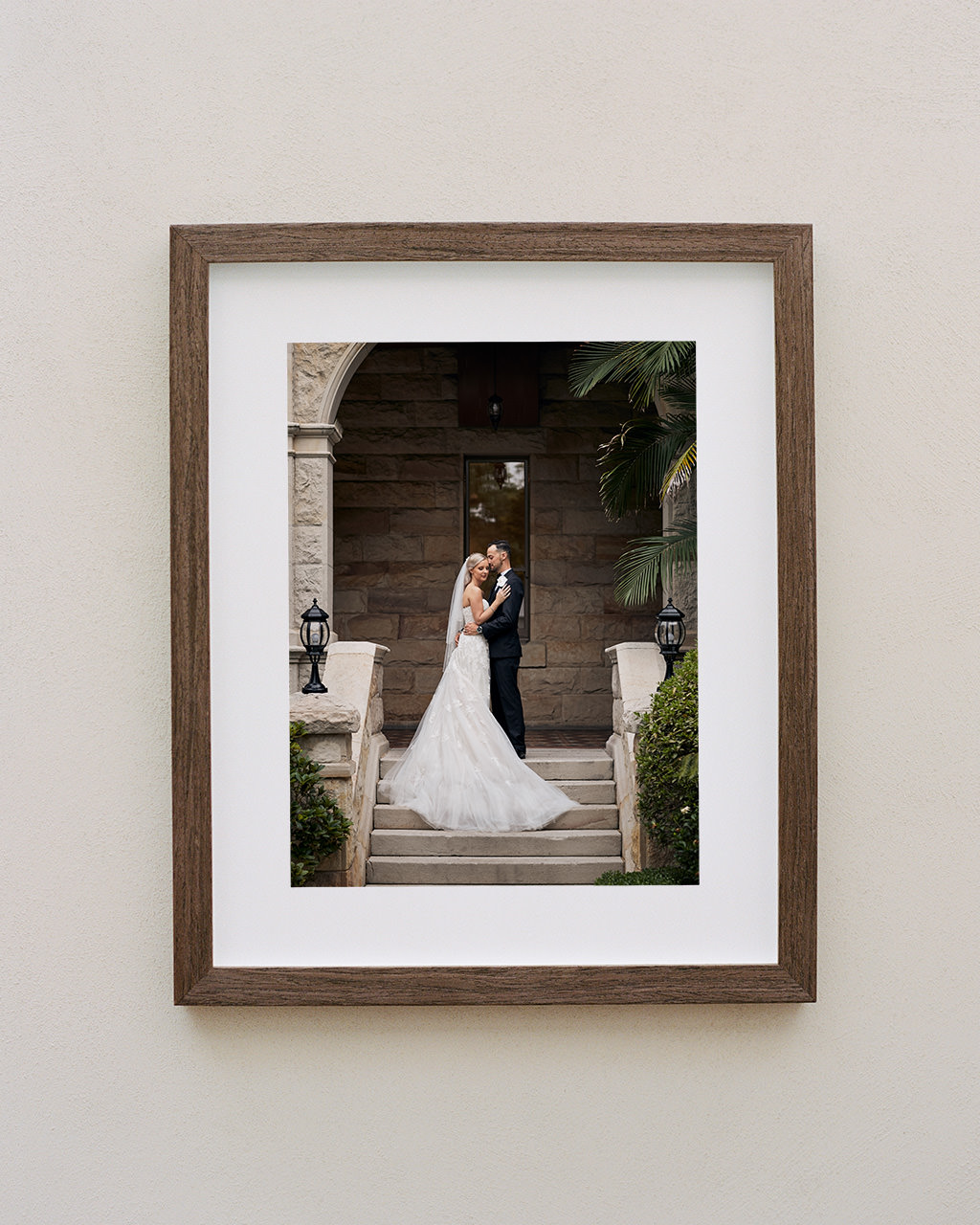 Framed portrait of couple on stairs at Curzon Hall wedding