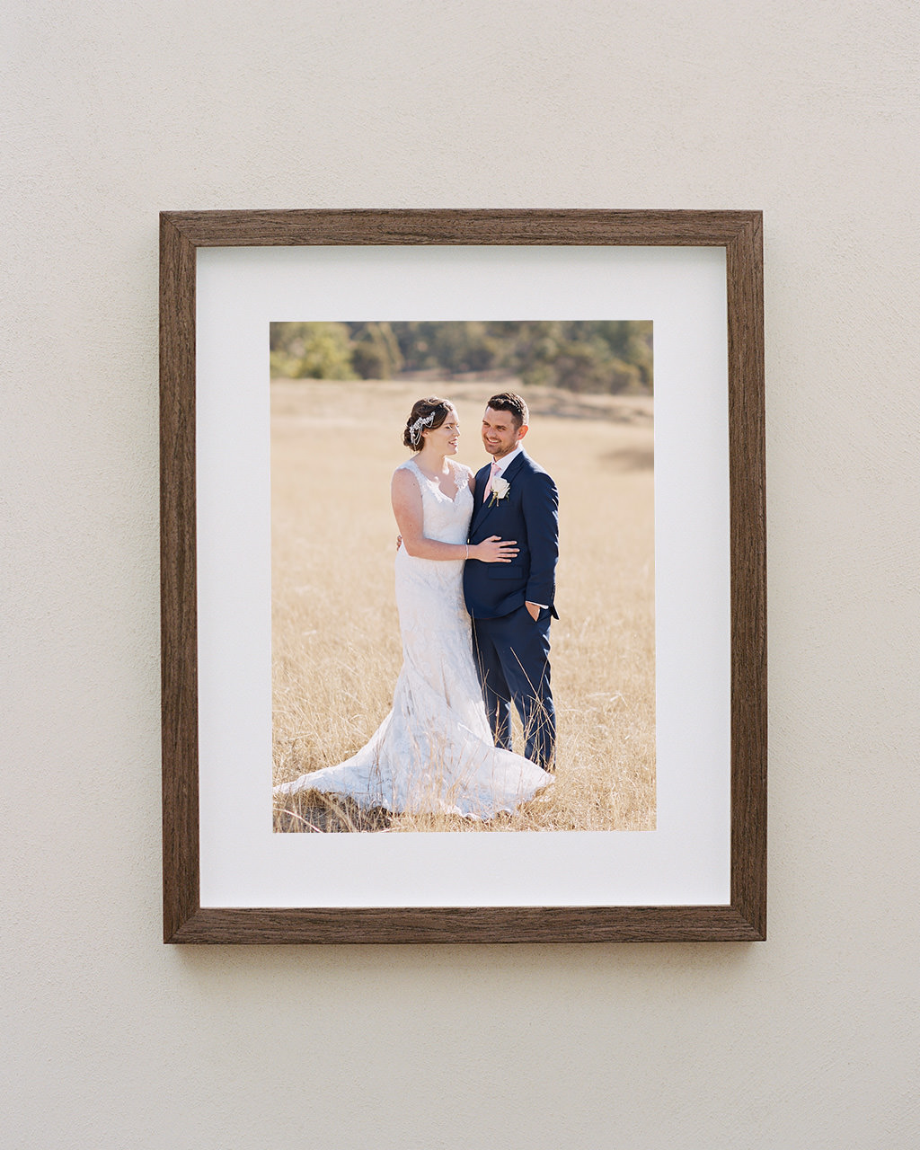 Framed portrait of couple in a field at their Adams Peak Country Estate wedding