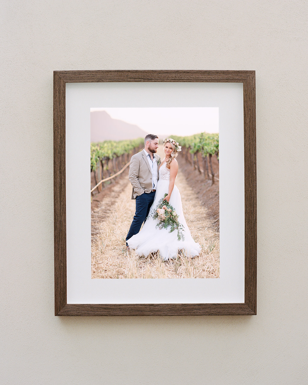 Framed portrait of couple standing in vineyards at their Estate Tuscany wedding