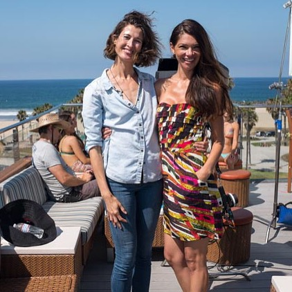Laura on set with her friend, actress Micaela Santos, in her au-courant denim on denim. (Photo by Jack Simon)