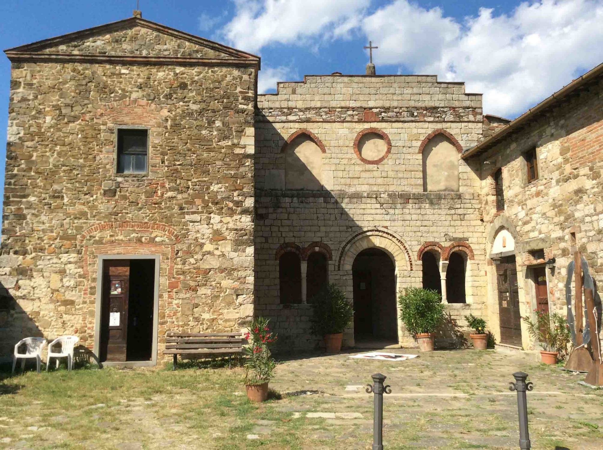 Entrance to the exhibition room/studio (left) church (centre) , artist accommodation (right)