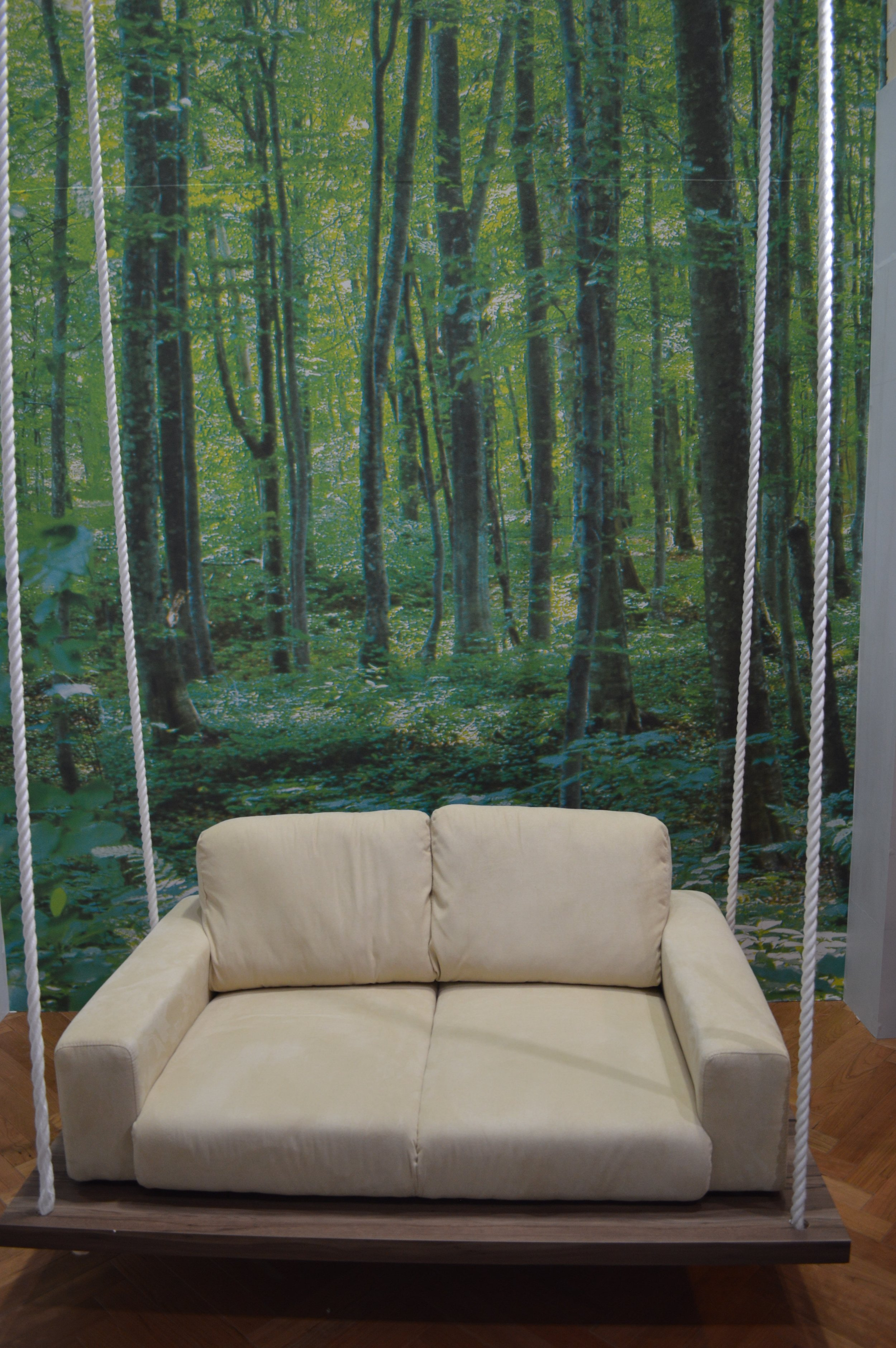 "Mori-no-yurayura Living Room: a swinging sofa in the ""forest"" of the living room."