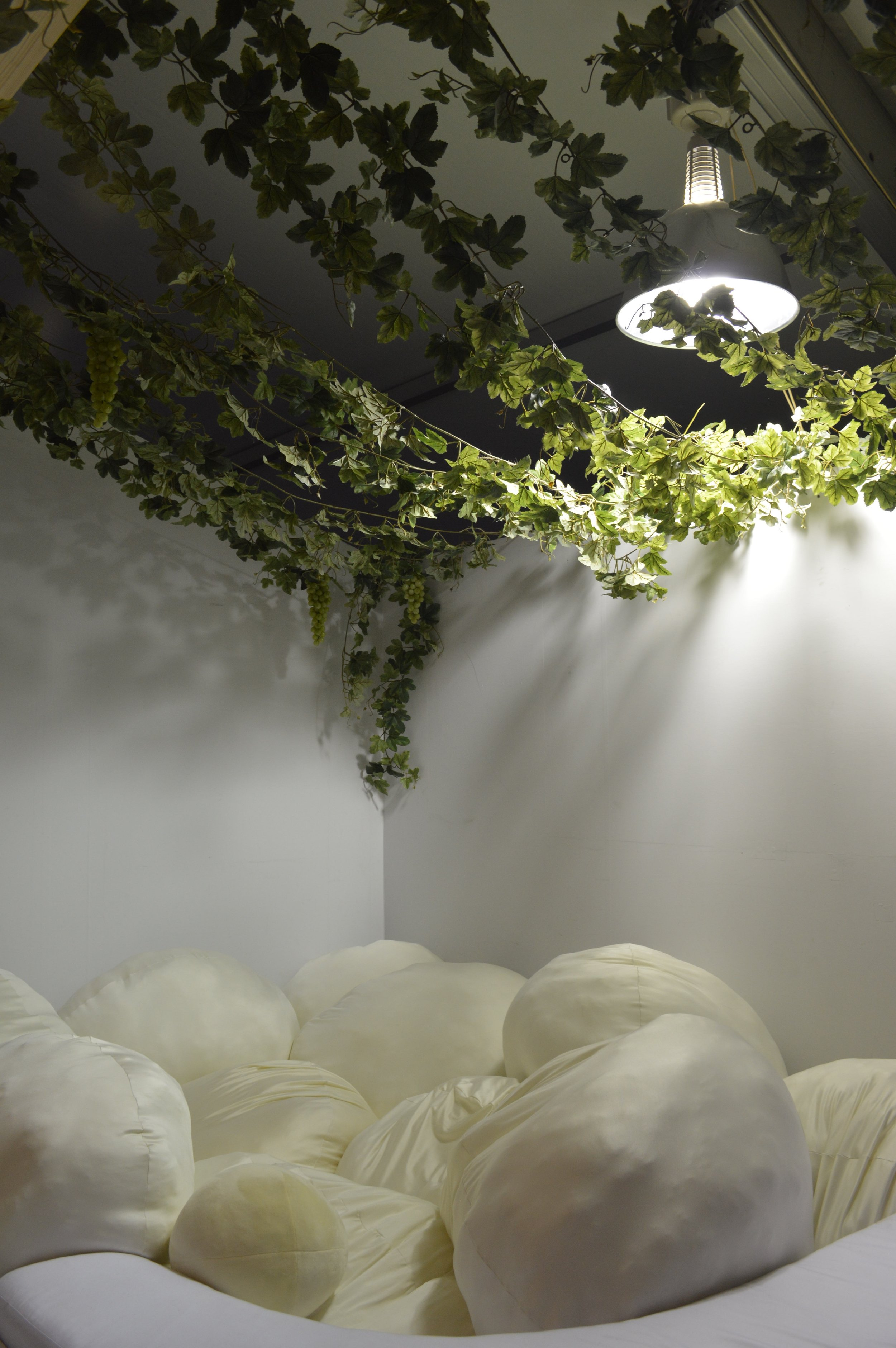 Howa-howa Komorebi Gym: This is a pillow pit with softly filtered sunlight. Sun shines through hanging vines into this soft cushion corner filled with egg-shaped squishy orbs, a place to lie, rest, and release the stresses of the city.