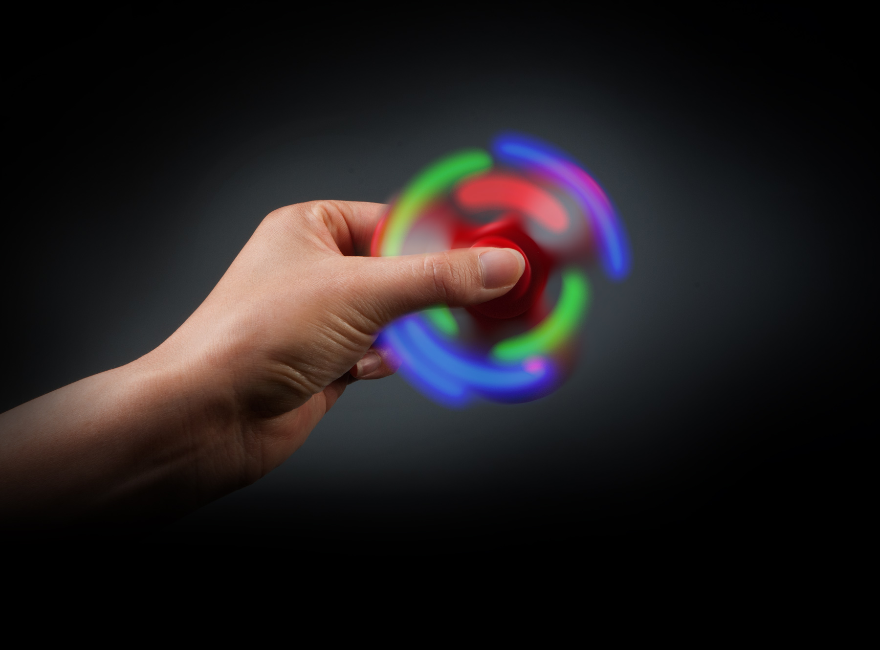 Photo used on fidget spinner display. A double exposure technique was used to capture the lighting effects. © E-filliate Inc.
