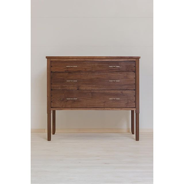 """""""The Wind is Low"""". Solid walnut three drawer dresser with soft close dovetail drawer boxes, hand carved legs, and our custom cast white bronze """"land of the sun"""" pulls. We'll have this on display at ICFF Booth 1579, or check out our website for more detail shots. Link in profile."""