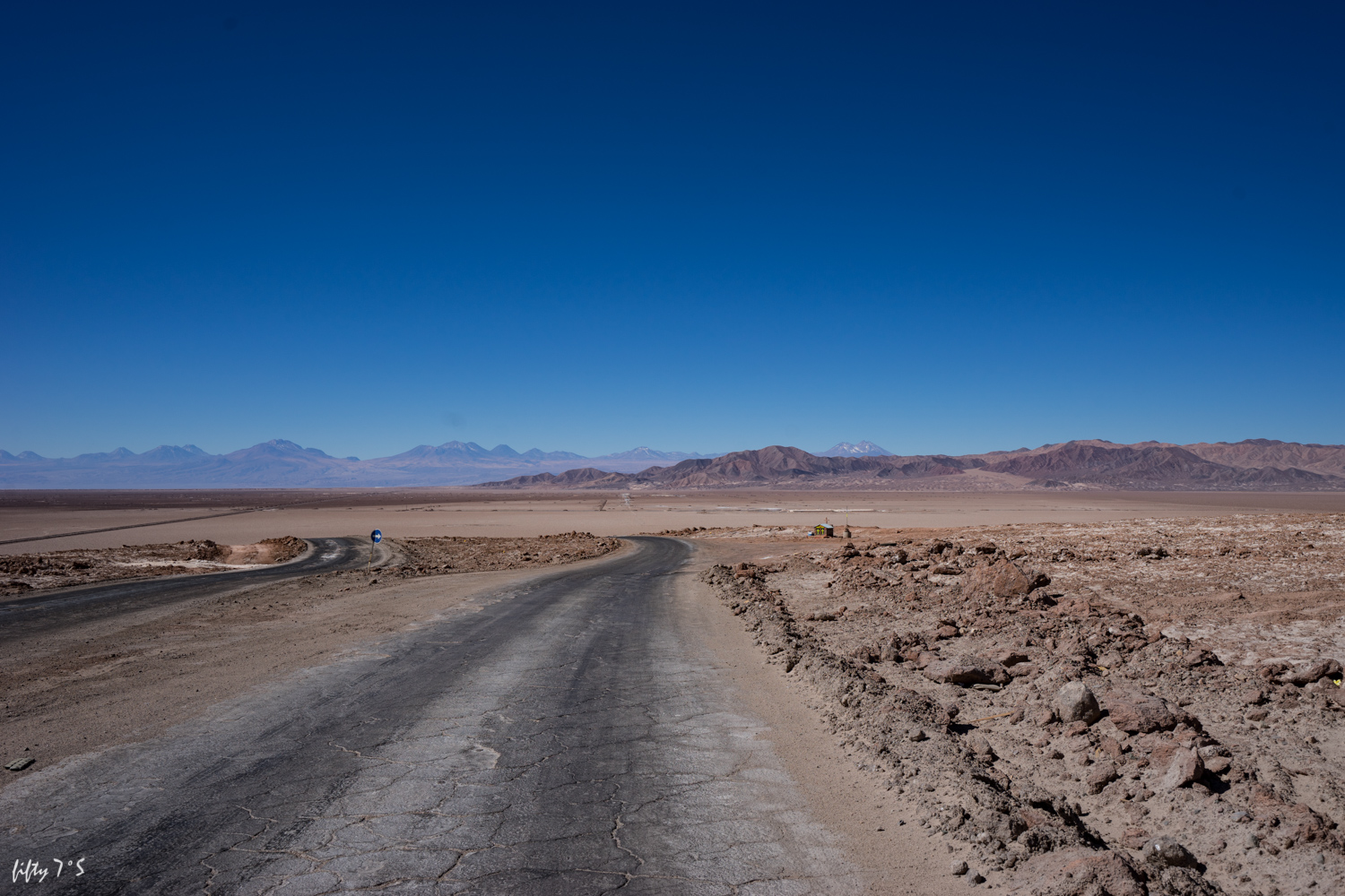 The Salar de Atacama is in a basin surrounded by volcanos, spectacular views for 360 degrees.