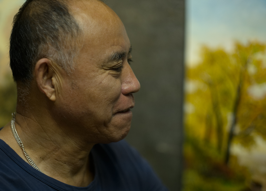 Concentration - A landscape painter concentrating on a delicate part of the painting - my presence goes unnoticed.jpg