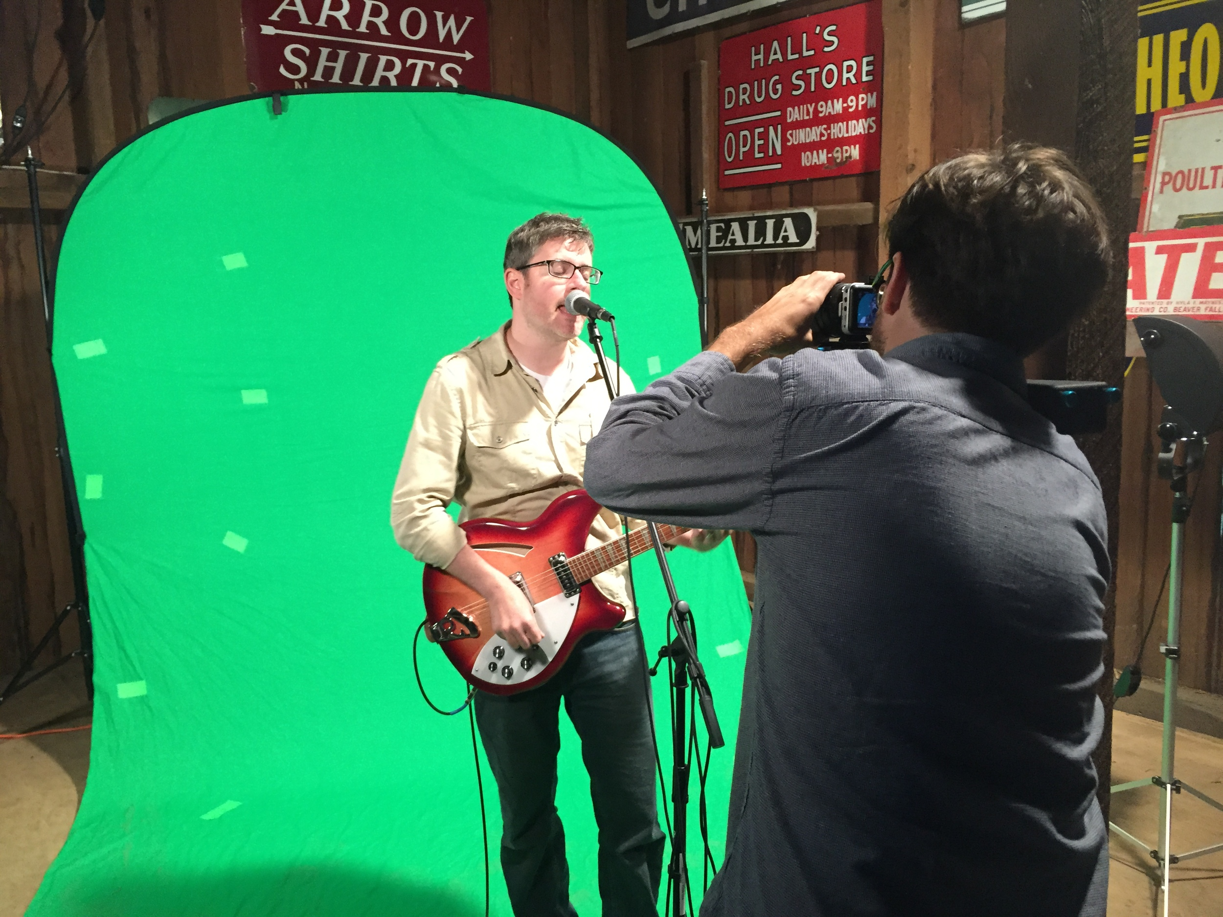 The green screen was used so that I could separate David, the lead singer, from the background. The idea was to foreshadow the latter half of the video by flashing different elements in the background, and ultimately, transport David to another realm.