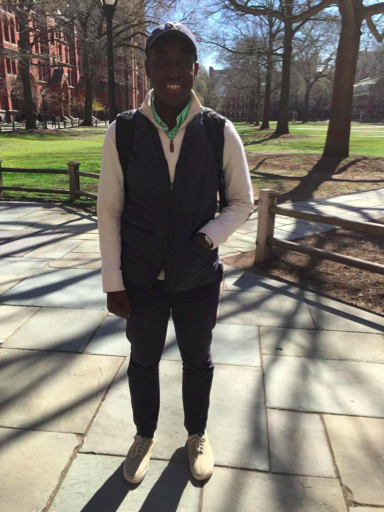 Andrew Siaw-Asamoah DC '19 wears a baseball hat, half-zip pullover, and a matching vest and pants.