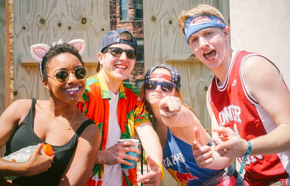 Left to right: Laura Anderson DC '17, Ali Lieberman '18, Harrison Tracy '18  Whether a backwards baseball cap or more avant-garde bandannas with logos and animal ears, headgear is a must for Spring Fling.