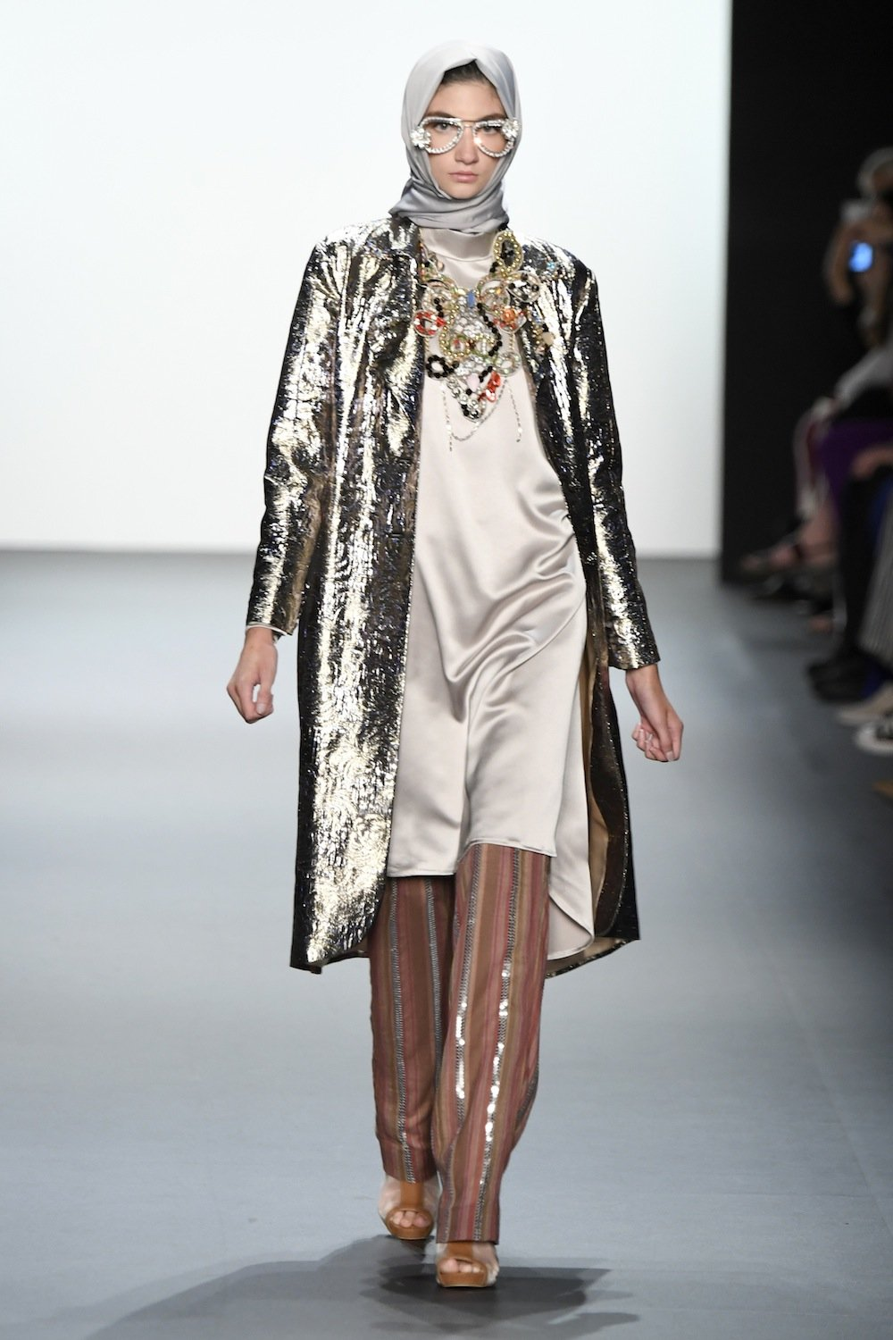 Hasibuan was not timid with metallics and ornate accessories