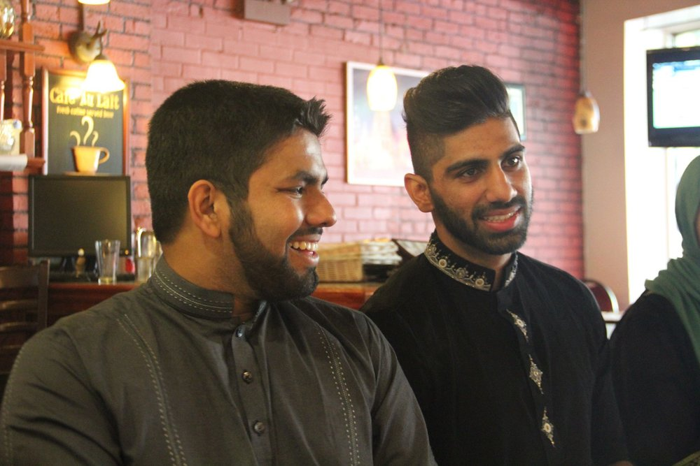 Muhammad Khan and Mustafa Malik, wearing traditional South Asian attire, show that stiff collars and subtle embroidery can go a long way.