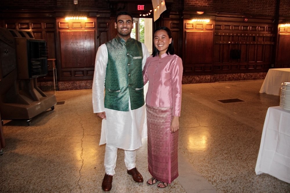 Omair Khan and Kate Tana shimmer in their glossy cultural attire.