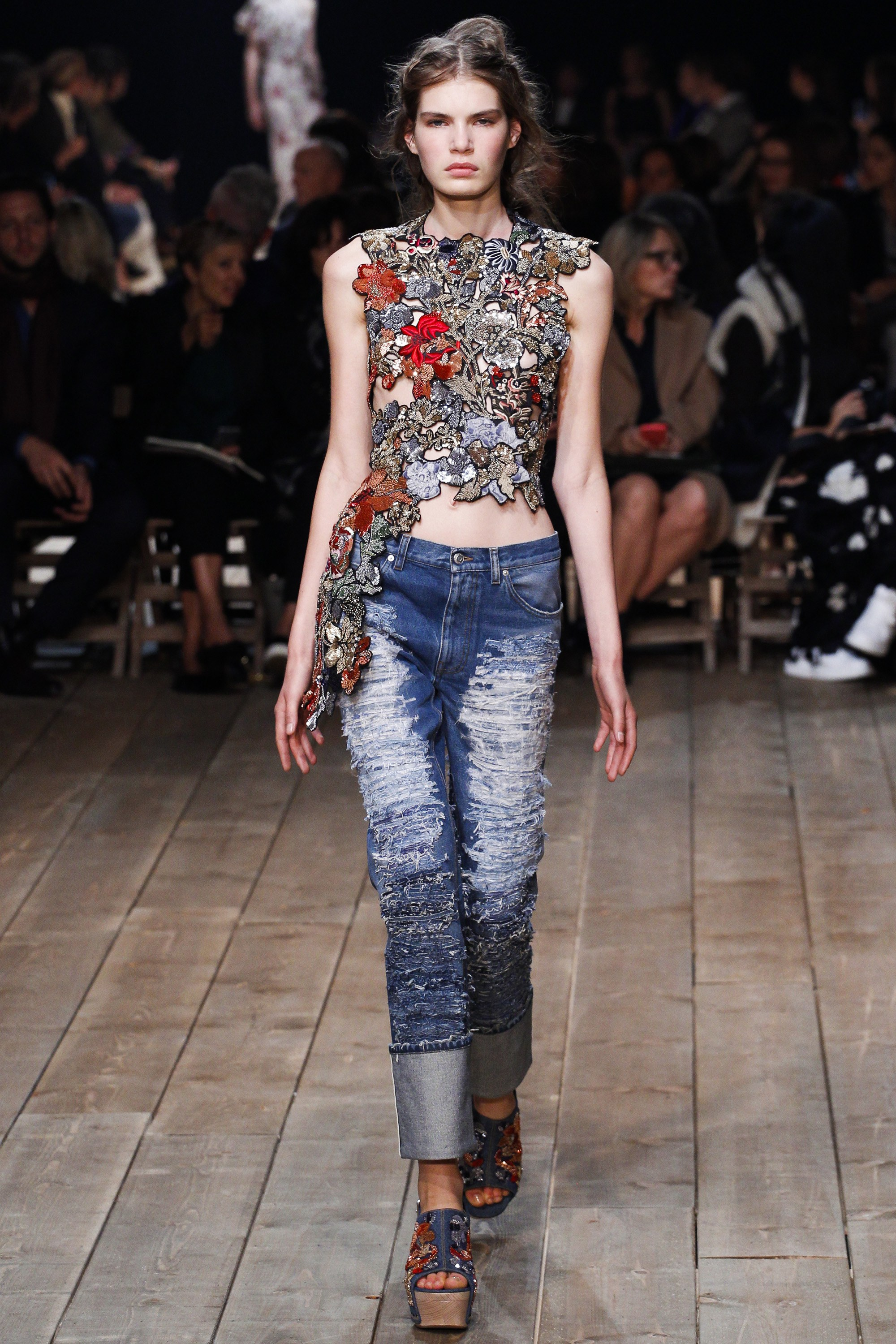 Alexander McQueen   (We're loving that mock-gaudy top with those ripped jeans; who knew McQueen could get even better?)   Source:  Vogue