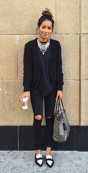 This model's statement necklace takes this all-black look to the next leve  (image via  media-cache )