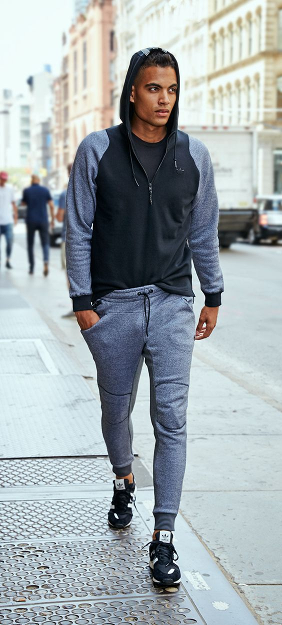 Track style jacket paired with gray joggers for a comfy street look (Image via  Media Cache )