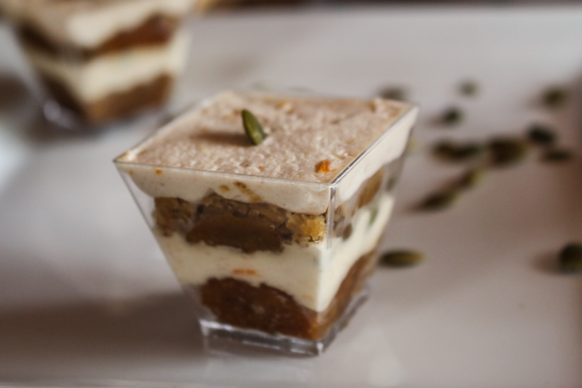 Pumpkin Trifle  Layers of roasted pumpkin cake with a freshly ground cinnamon & orange whipped cream & toasted pumpkin seeds