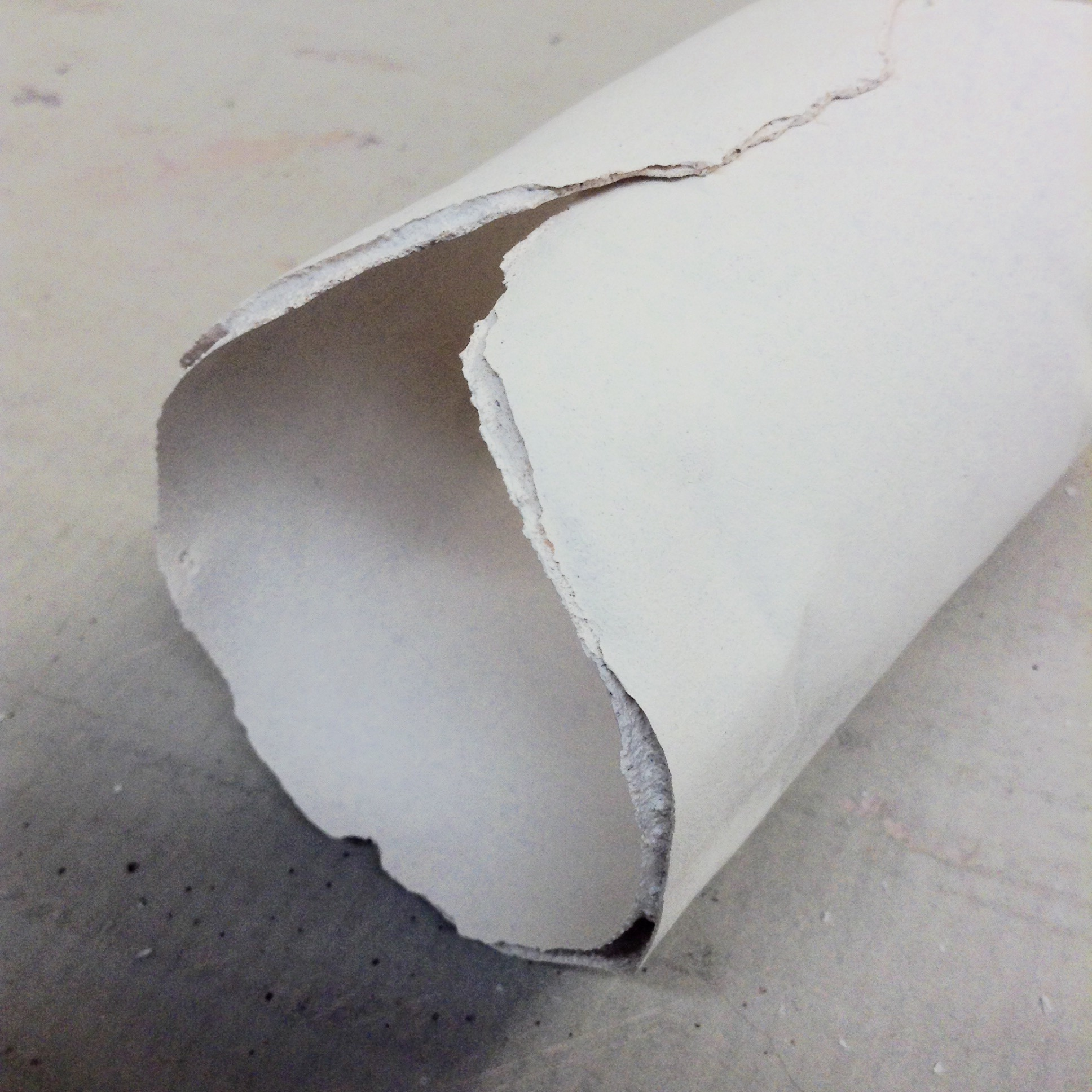 Another view of my favorite edge effect. This tube is completely enclosed on itself. It is not connected at that overlap because paper was between the clay layers. If this piece were glazed, the glaze would fuse those edges together for stability.