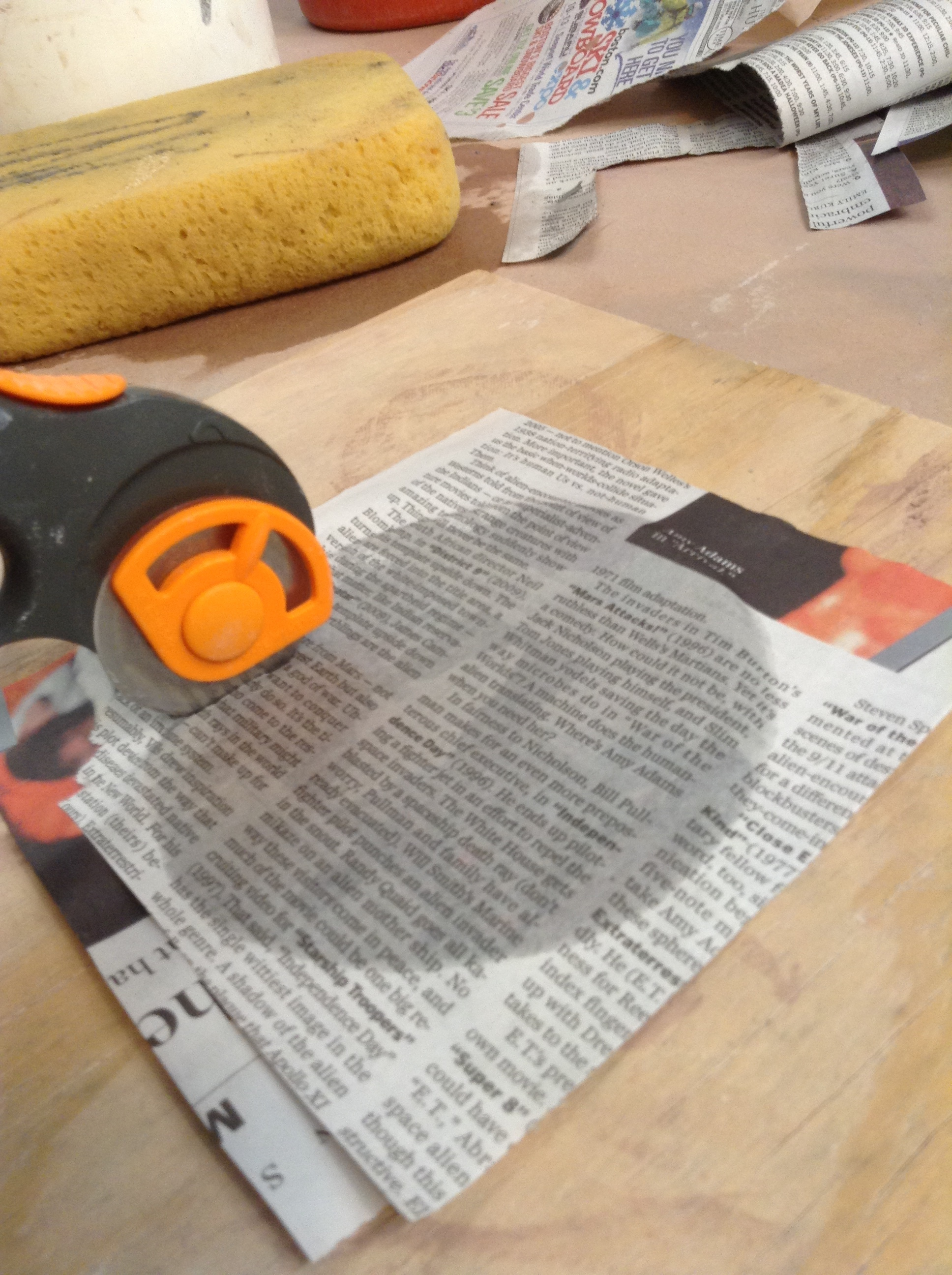 The fabric rotary cutter shown here makes good cuts, but seemed to get dull quickly. This laminate is certainly not official rotary cutting material. Soon afterward I experimented with making cuts with plain scissors and liked it much better.