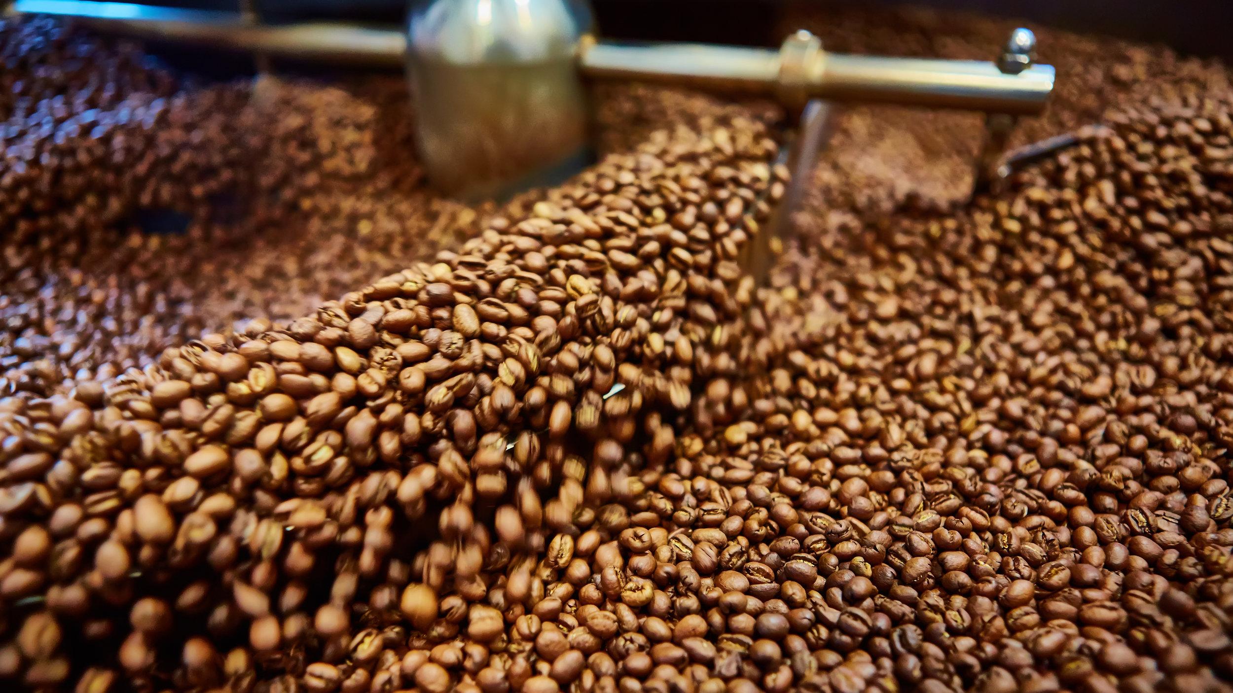 bigstock-Freshly-roasted-coffee-beans-107098928.jpg