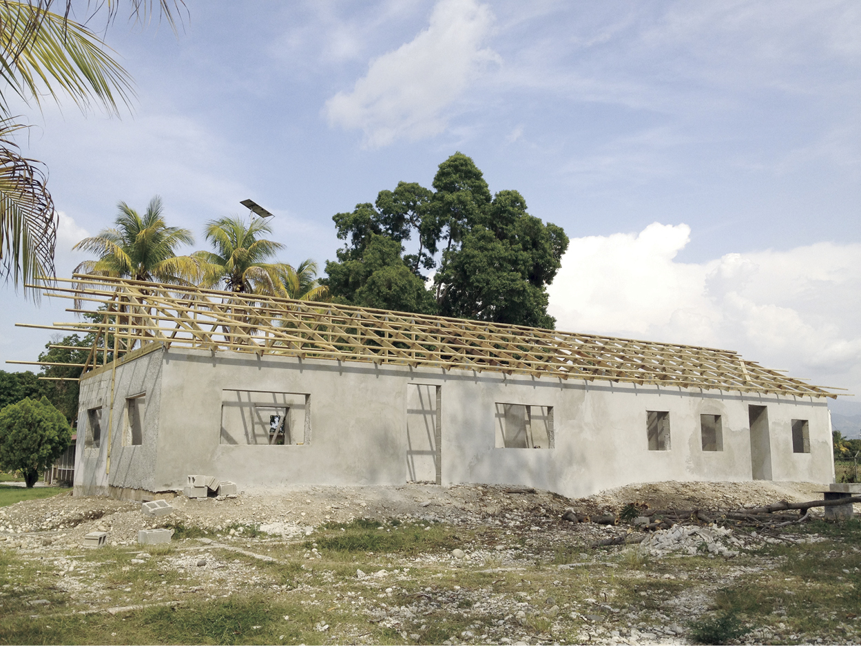 Construction at New Missions is accomplished by Haitians who are leading the efforts to build a new Haiti.