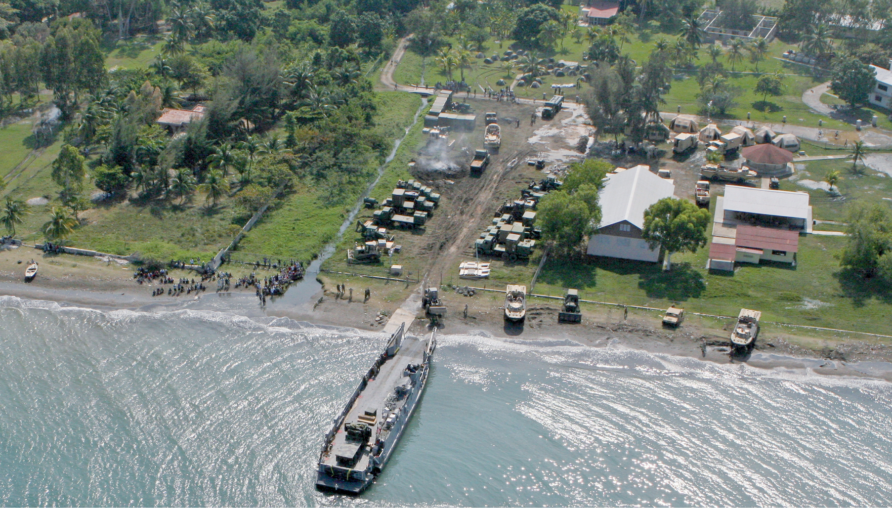 The U.S. Navy and Marines have established New Missions as their base camp for the Leogane area. This aerial photograph captured by the U.S. Navy shows our campus on the ocean at Bordmer, Leogane, Haiti.