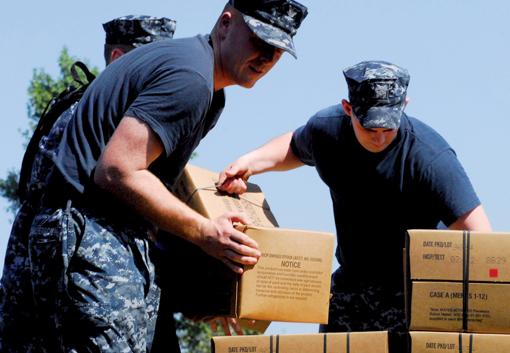 U.S. Navy distributed food at our surrounding schools. These MREs (meals ready to eat) are a blessing to children and their families.