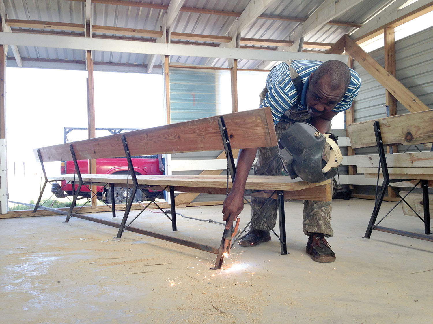 Luc Bertrand, a graduate of New Missions from Neply, Haiti, is our welder who makes the legs for our church benches.