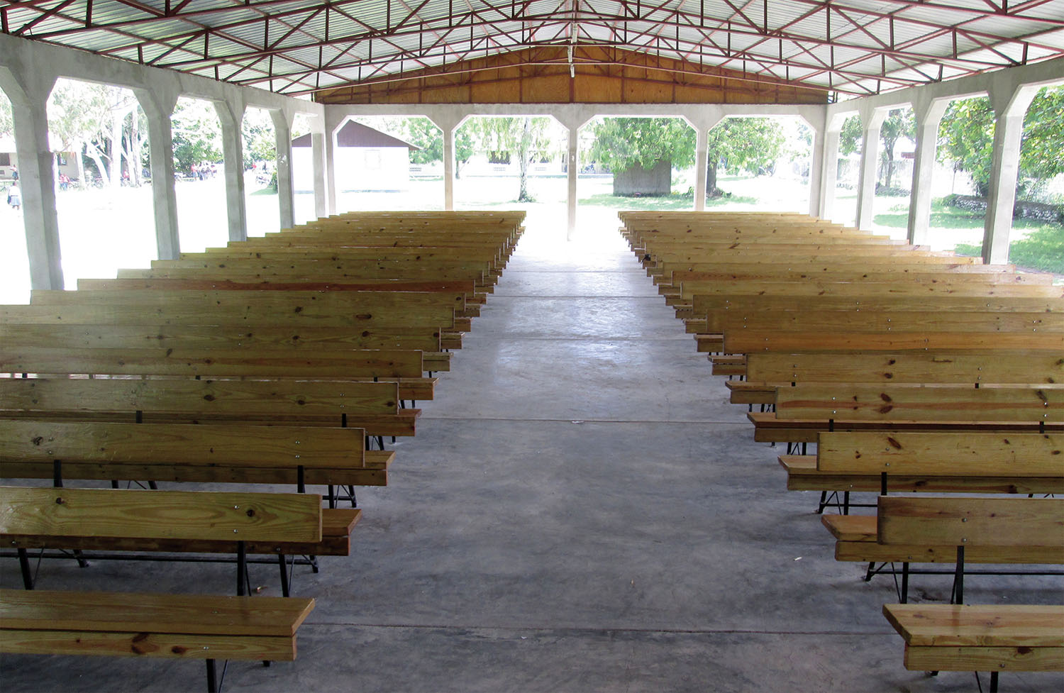 New church benches have been installed at our church in Signeau, Haiti, and also at our high school chapel.