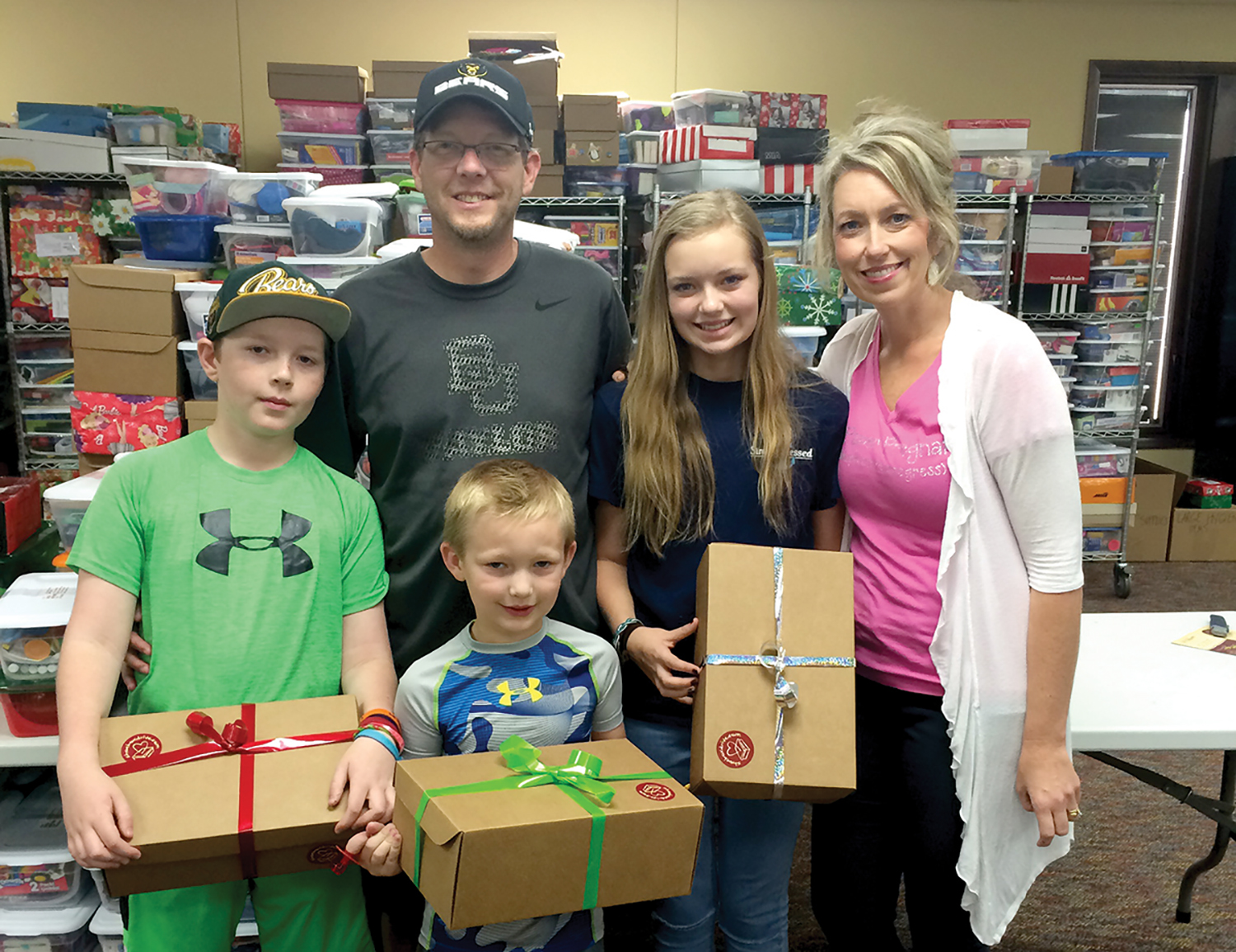 The Butler family from Texas was on vacation in Orlando, and spent a day helping process shoeboxes.