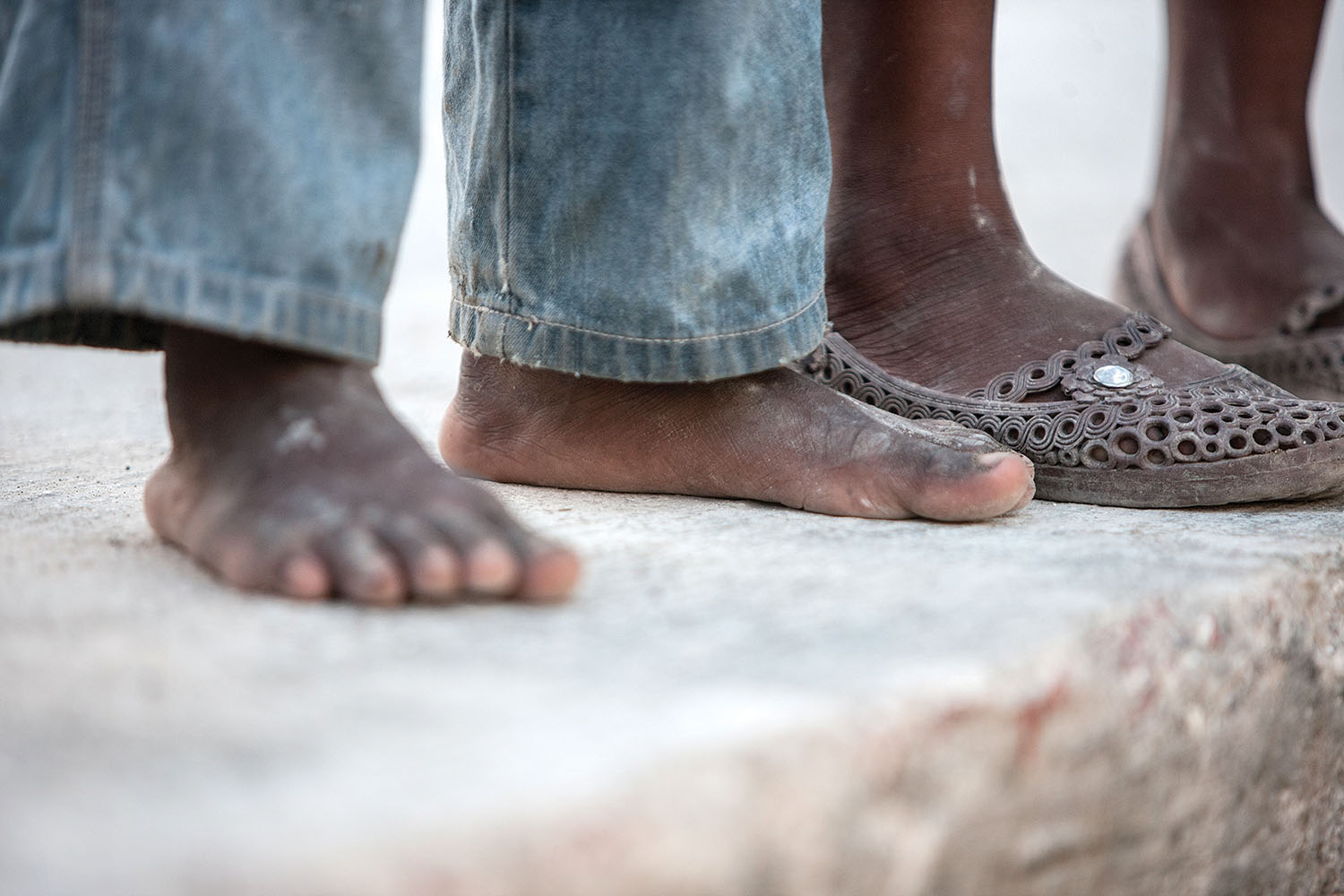 None of us like to see our Haitian children barefooted.