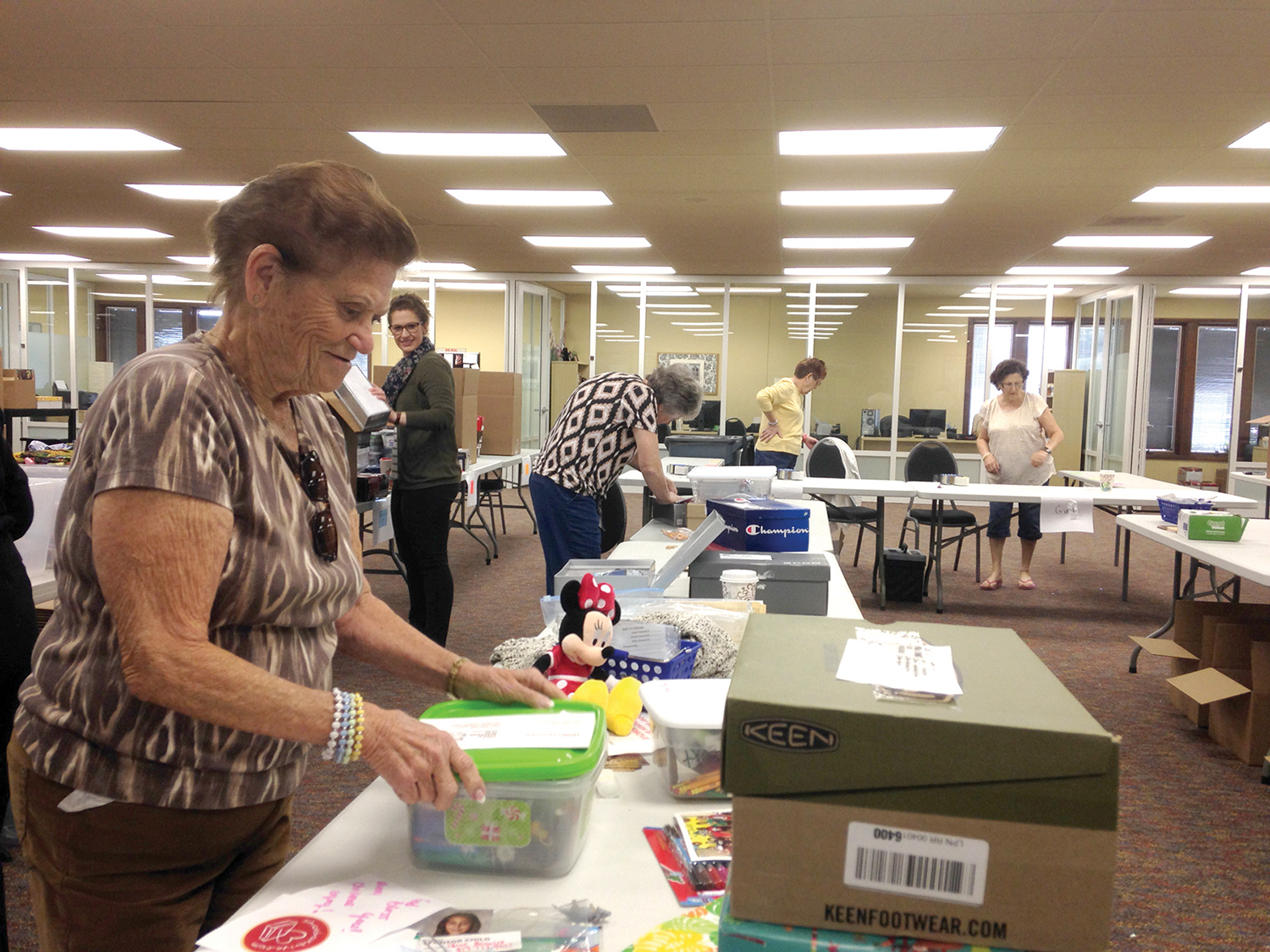 Volunteers serving in Orlando, Florida, help us pack and ship shoebox gifts to Haiti.